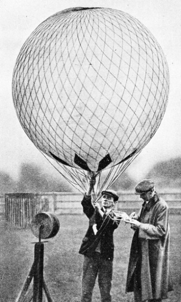 CAPTIVE BALLOONS have been used to carry scientific instruments up into the fog at Kew Gardens, Surrey