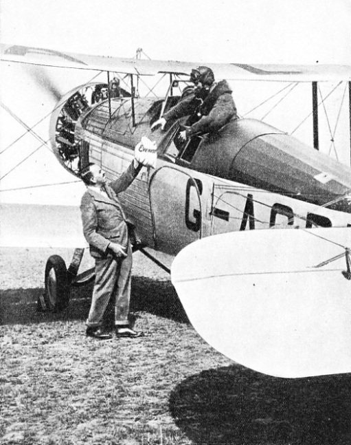 THE EVEREST MAIL being handed over to the pilot of the Westland Wallace machine before the flight over Mount Everest