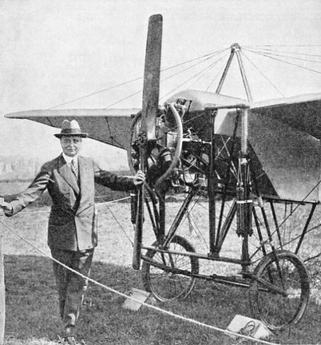 Bleriot standing beside a modern replica of one of his early monoplanes