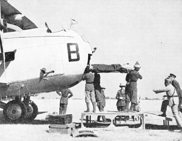 a casualty from the Waziristan operations in 1937 being taken out of an aeroplane at Rawalapindi, in the Punjab