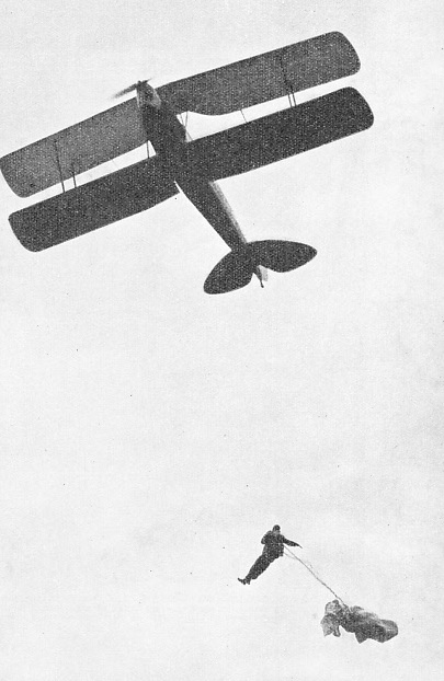 JUMPING FROM LESS THAN 300 FEET, Carl Siemendl demonstrated a new type of parachute at Luton Airport in 1938