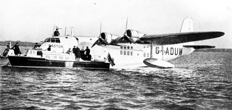 CASTOR, ONE OF THE EMPIRE FLYING BOATS, being loaded at Hythe