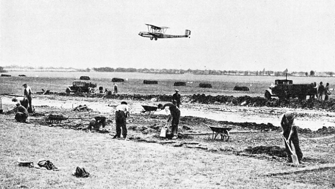 A SECTION OF CROYDON AIRPORT being levelled by hand