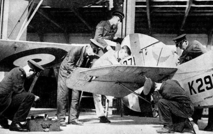 Aircraftmen adjusting the tail unit of a No. 601 (County of London Squadron) machine