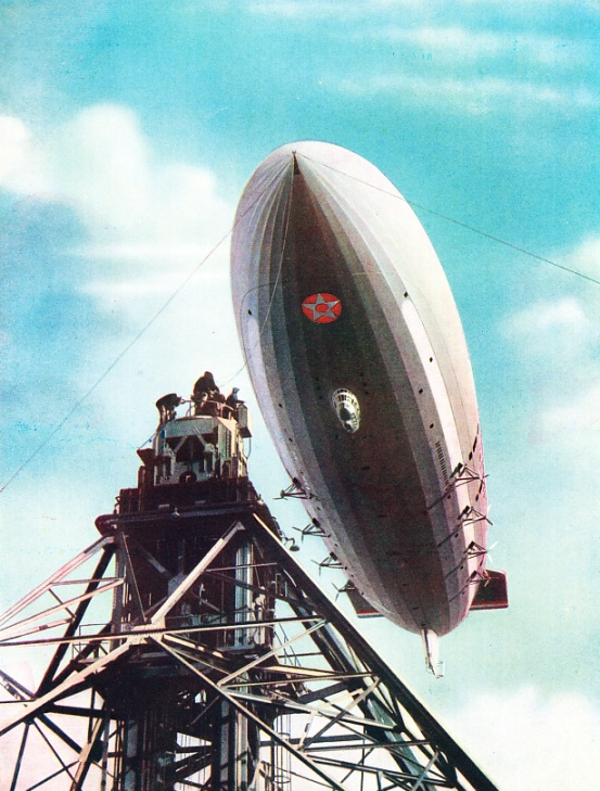 THE U.S. AIRSHIP MACON being moored to the mobile mast at Lakehurst, New Jersey